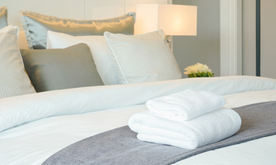 Close up of bed with folded towels