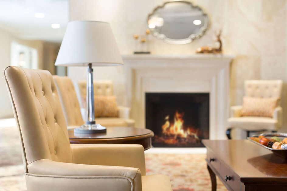 Fireplace lounge at Amica Aspen Woods senior living residence.